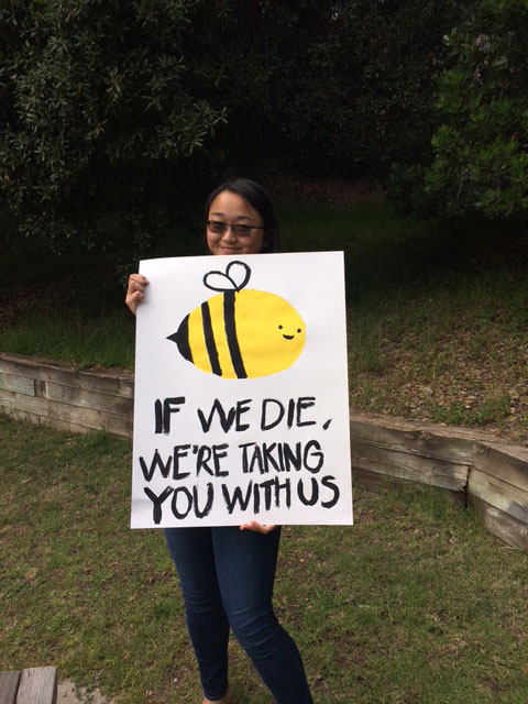 Student sign with a smiling bee saying