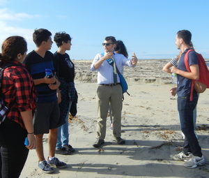 Students listen to a guest lecturer near the California-Mexico border.