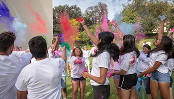 Students participate in the Hindu holiday of Holi on Oxy's campus