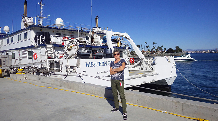 Professor Shana Goffredi in front of a research ship