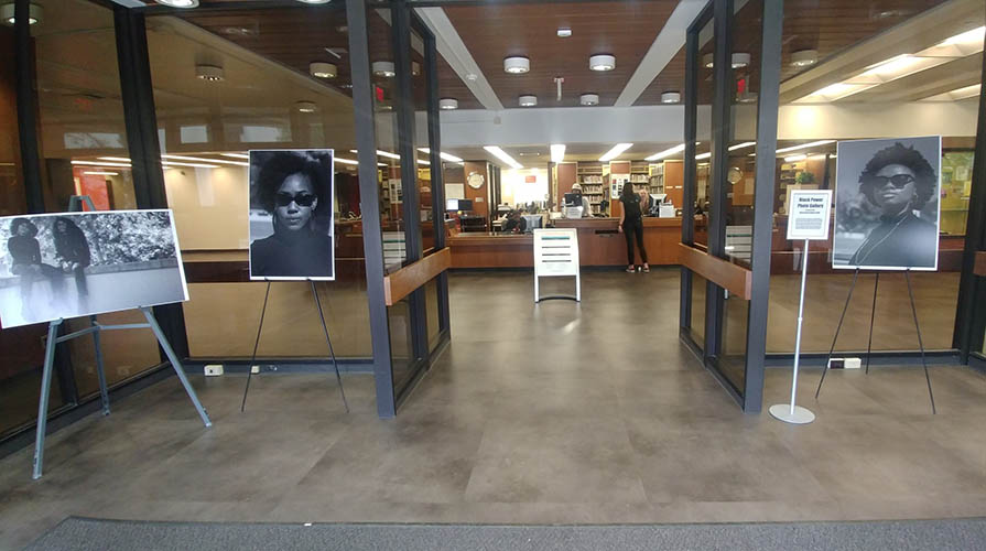 Art displayed in entryway to Academic Commons building on campus