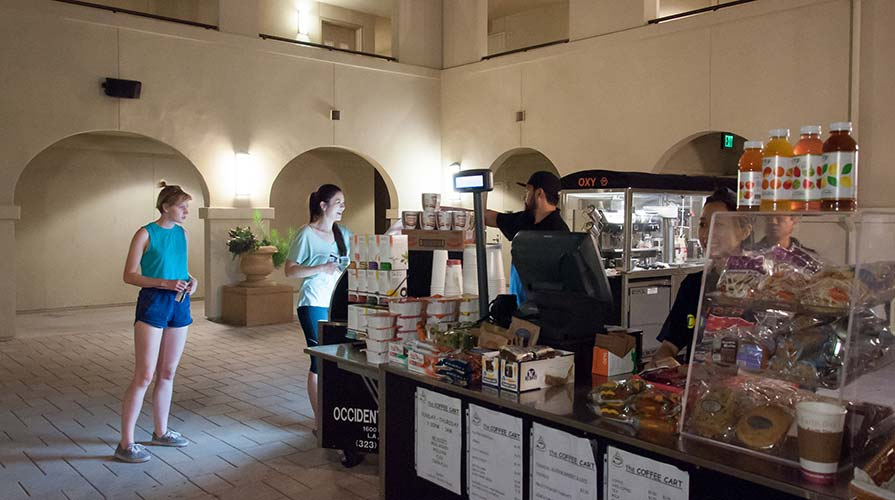 Students grab a late night snack at the Coffee Cart in Berkus Hall