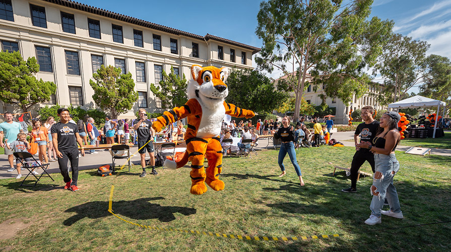 Oswald and students jump rope on the quad