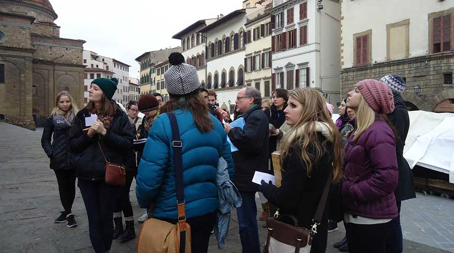 A class of Oxy students abroad look at surrounding architecture