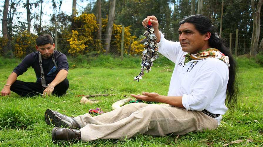 A man displays craftwork in Latin America