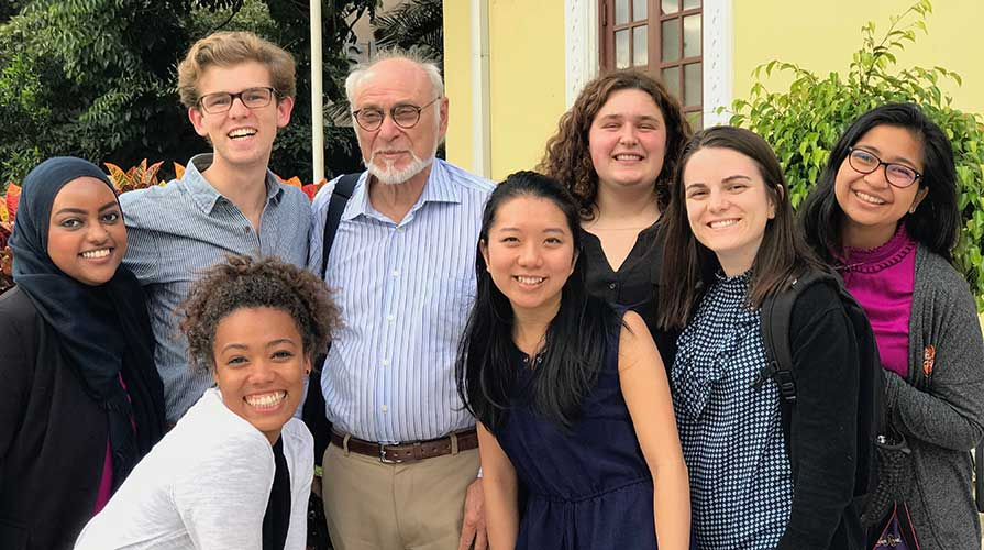 Students gather with a professor
