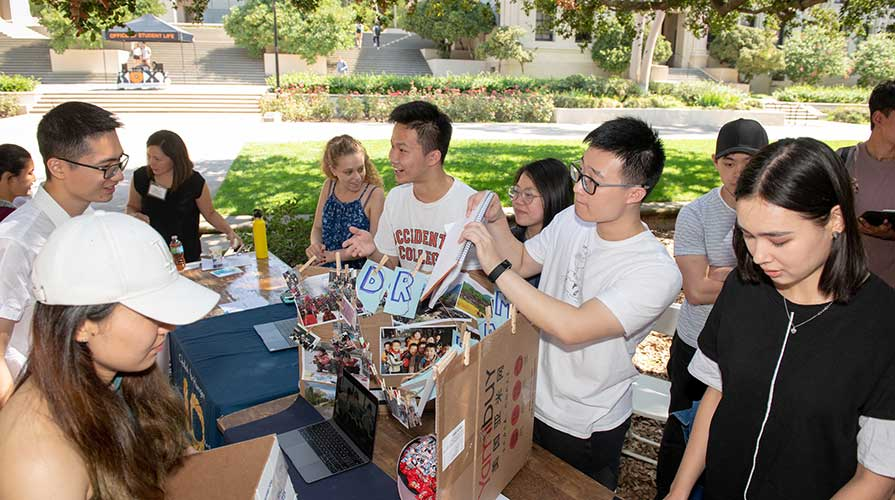 Oxy students at an involvement fair on campus
