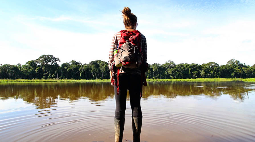 Student standing in a river