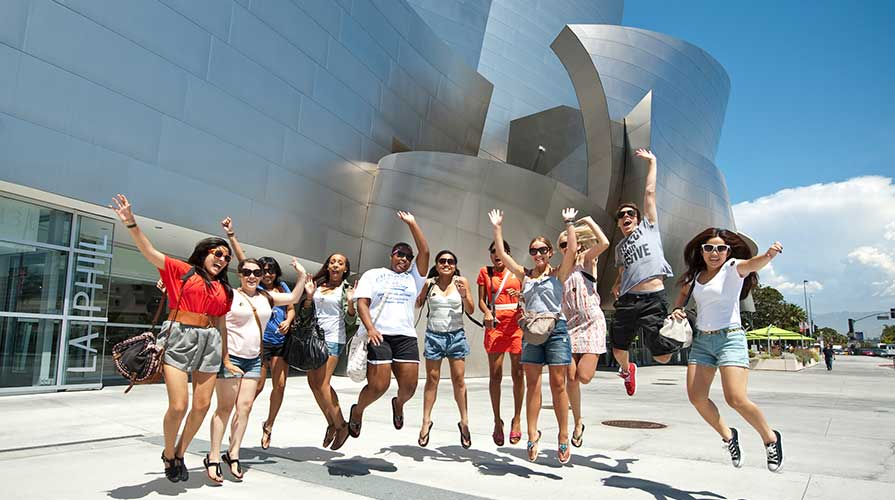 Students pose in front of Disney Hall in downtown LA