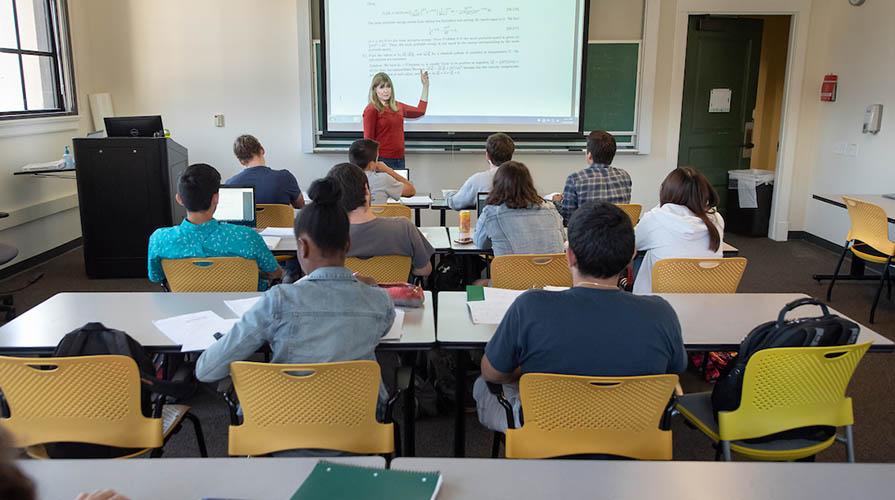 Professor Janet Scheel teaching a physics class