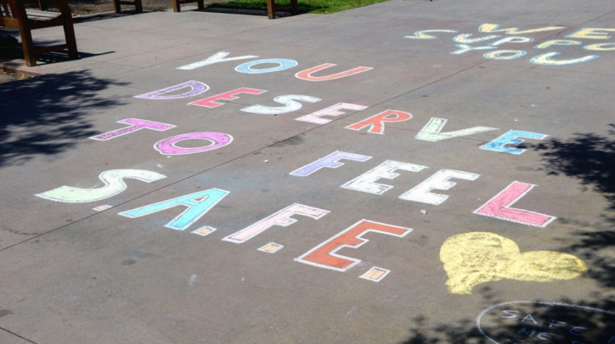 Chalk drawings by Project SAFE on campus