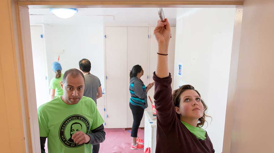 Students renovating a house as volunteer workers