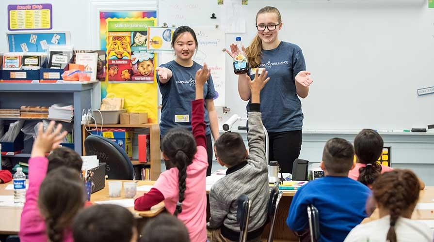 Oxy students volunteering in elementary school classrooms