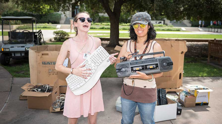 Oxy students holding e-waste at a recycling drive on campus