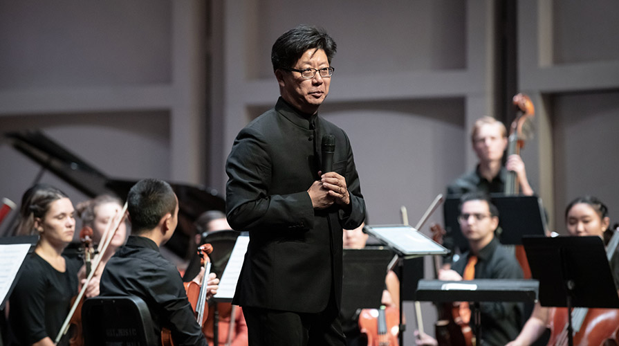 Conductor Chris Kim and the orchestra