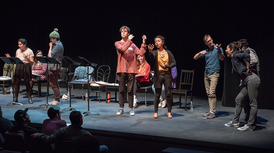 Students perform on stage at the New Play Festival