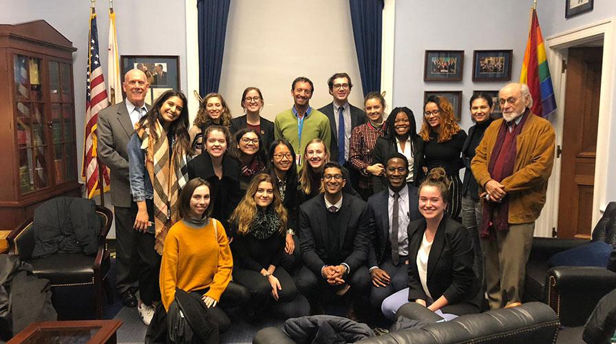Students pose with California Representative Adam Schiff in his NY office