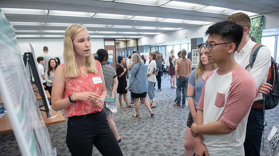 A student presents her research at the 2018 Summer Research Conference