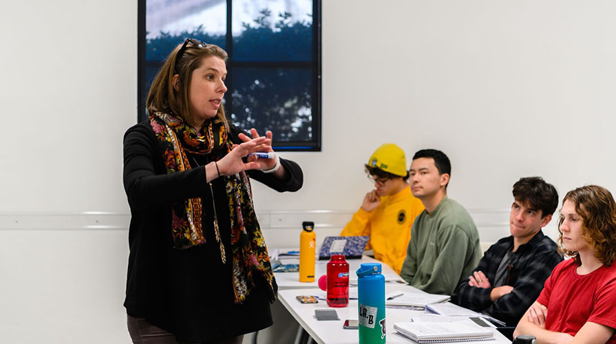 Professor Clair Morrissey in a classroom with her students