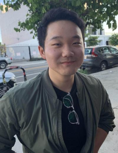 Brendan Kim standing on the street