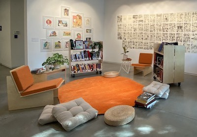 Oxy Arts Community Room with books and chairs