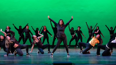 Dance Pro dancers perform in front of green background