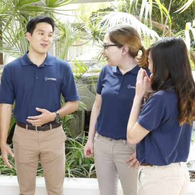 students in COPE Health Schoalrs uniform talking outdoors