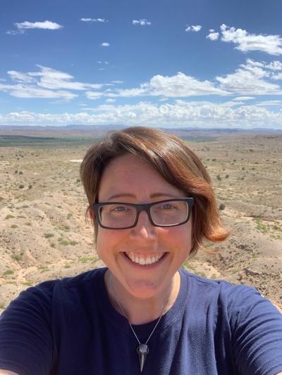 Dr. Kate Boersma in front of desert landscape