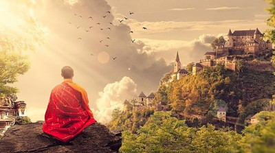 A monk meditates on a mountain top in front of a distant temple surrounded by a peaceful landscape of birds and trees