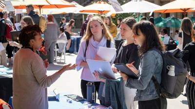 Students talk with employers at the Oxy Career Fair