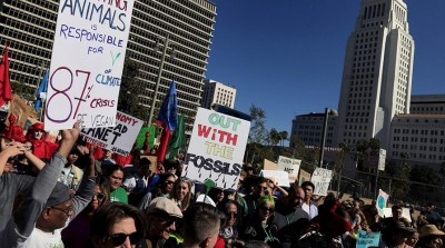 Climate change protestors march in downtown Los Angeles