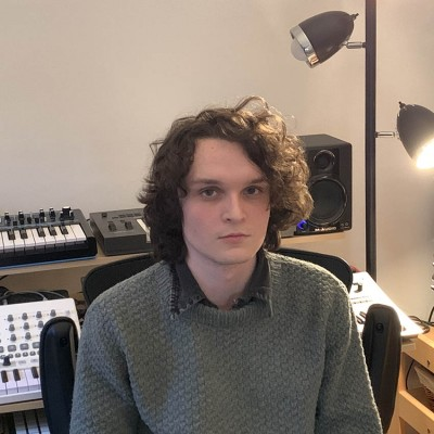 Will Black sitting in front of synthesizers