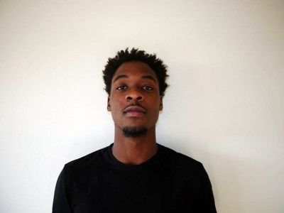 Zion Alcindor in front of a wall