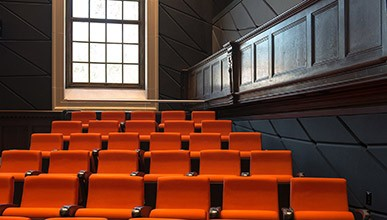 Orange seats on the inside of Choi theater