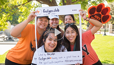 Five students pose surrounded by white poster board reminiscent of Instagram with handle @firstgen.club