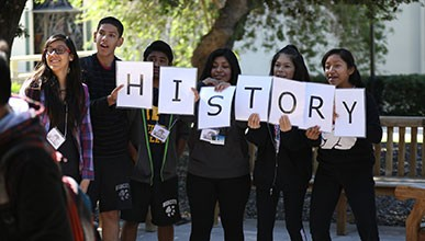 "Gear Up students hold a sign that reads ""History"""