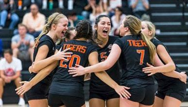Oxy volleyball players in a huddle