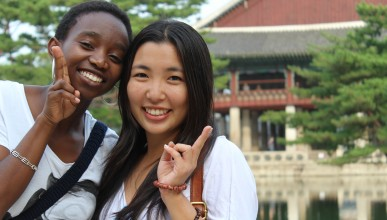 Diverse students pose together in Asia