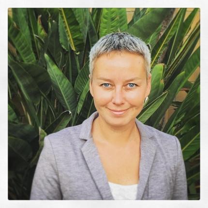Dr. Katie Zyuzin in front of plants