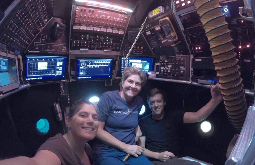 Shana Goffredi, Victoria Orphan and pilot Danik Forsman inside the Alvin submarine