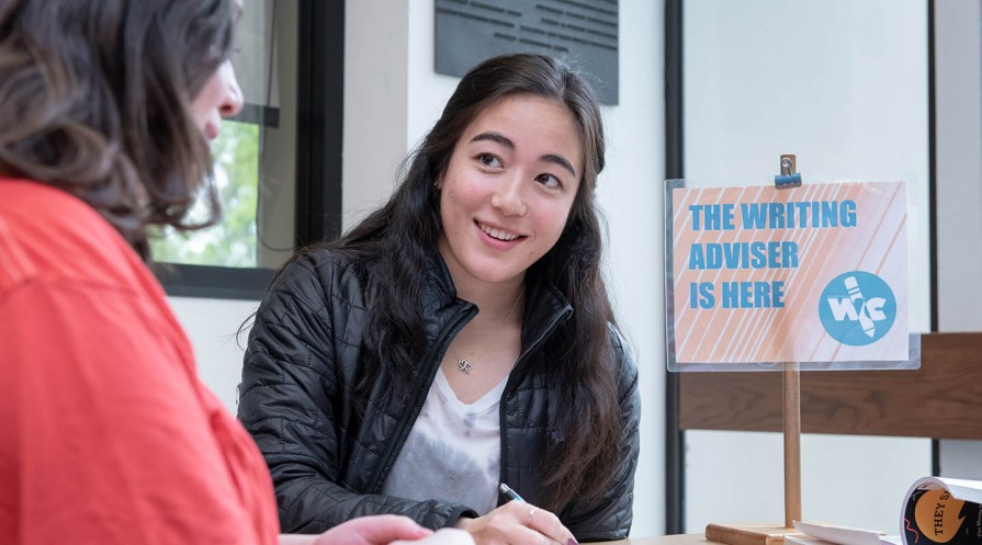 A student writing advisor at the writing center
