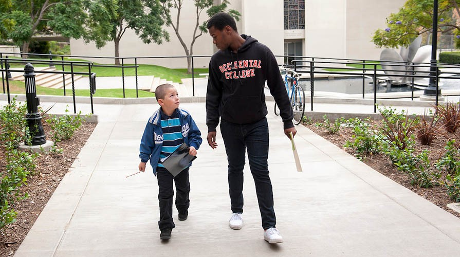 An Oxy student and a young child