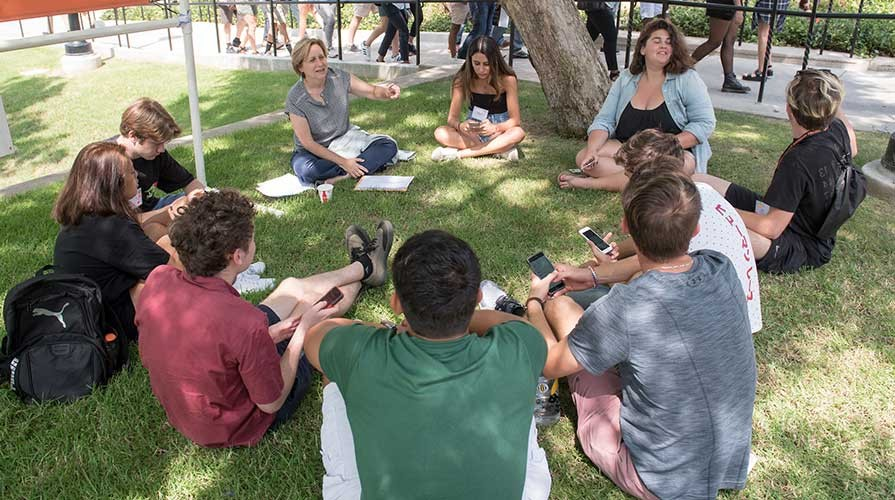 Oxy students and faculty outside on the grass