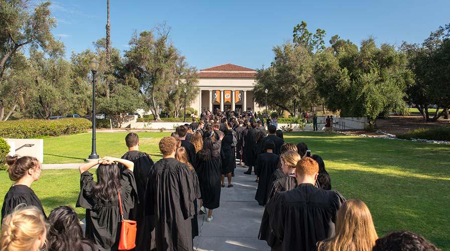 Students march towards Thorne Hall for Convocation