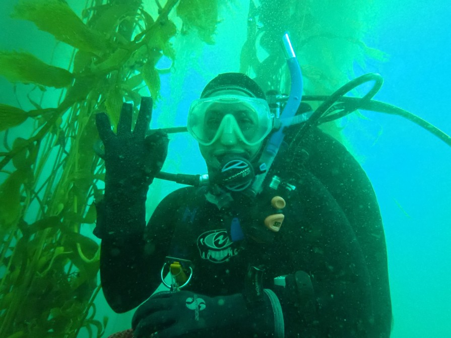 Sarah Traiger diving in kelp forest