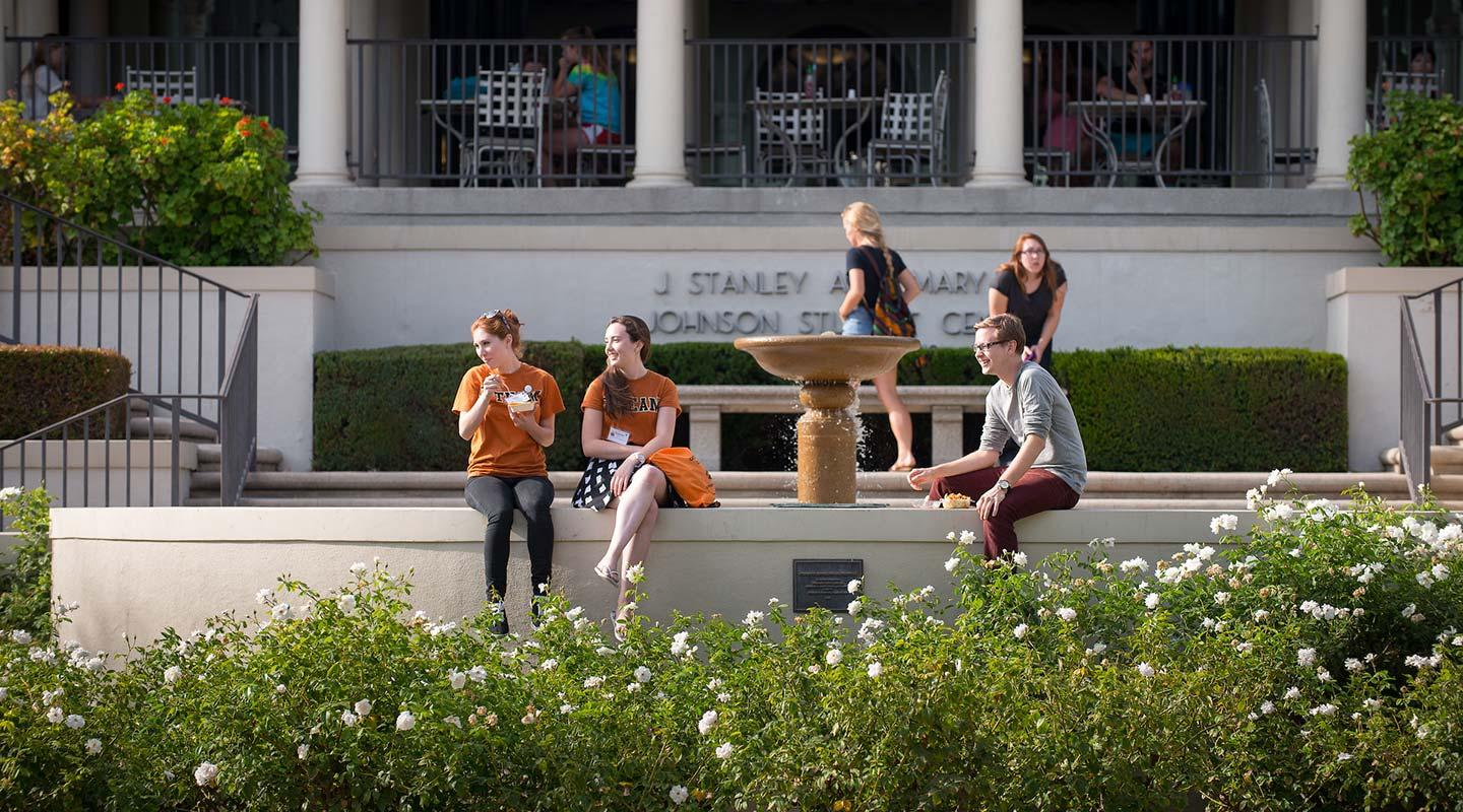 Students relax in front of Johnson Student Center