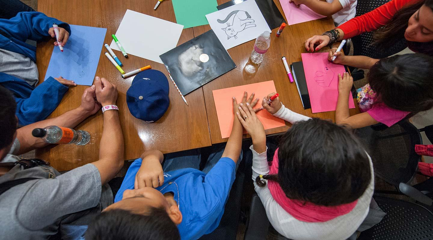 "The California Immigration Semester (CIS) and Center for Community Based Learning (CCBL) hosts a group of local elementary school students as part of a ""Day at College"" event."