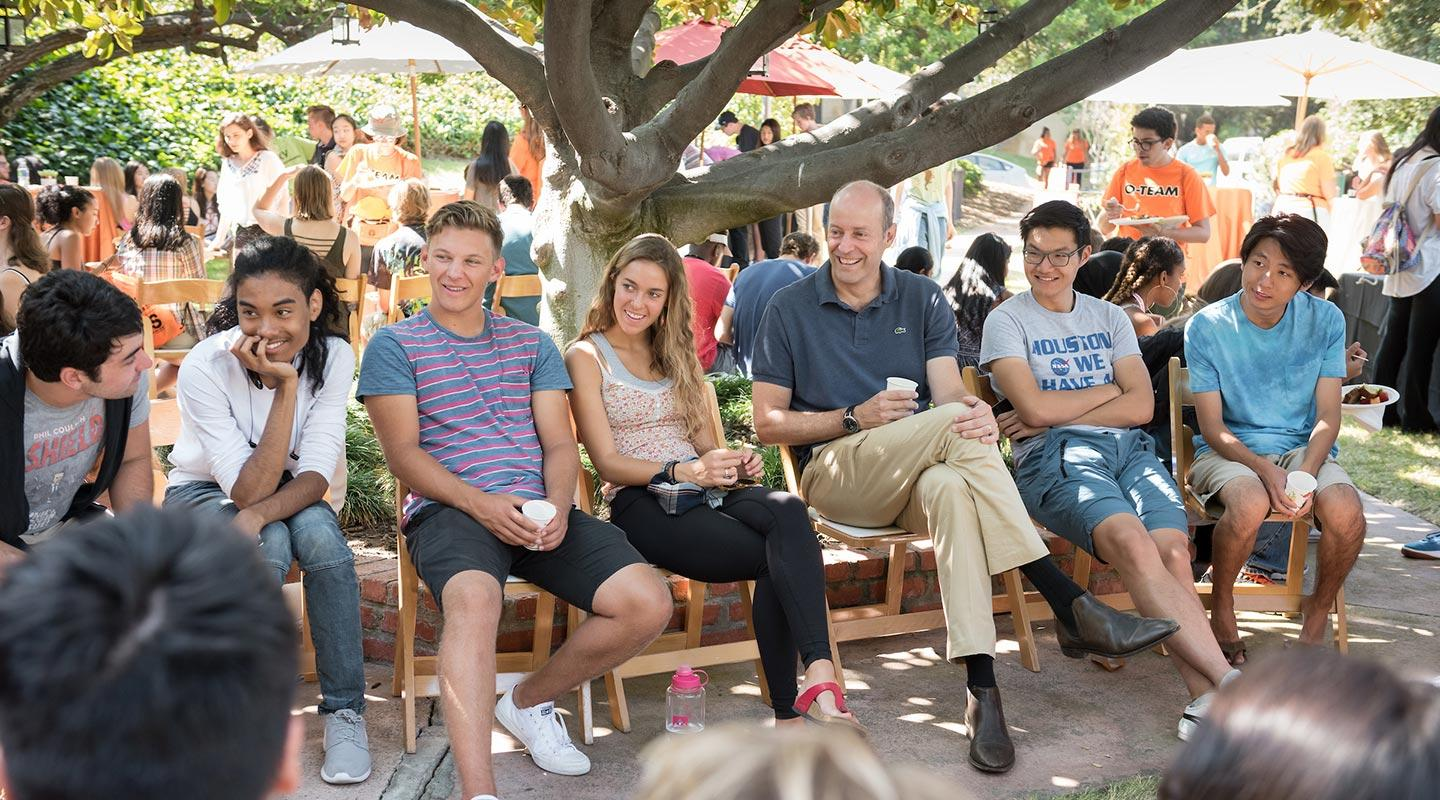 President Veitch sits with students on the Oxy quad