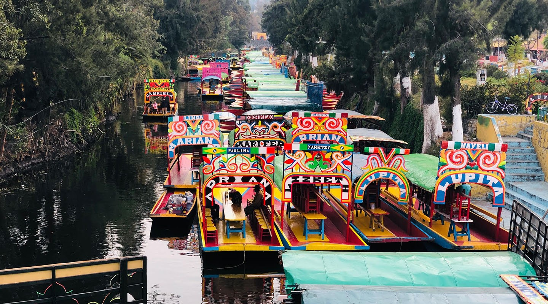 Colorful Trajinera boats at Xochimilco: showcasing a pre-hispanic canal system of Mexico City