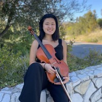 Hyun Gill sitting with her viola